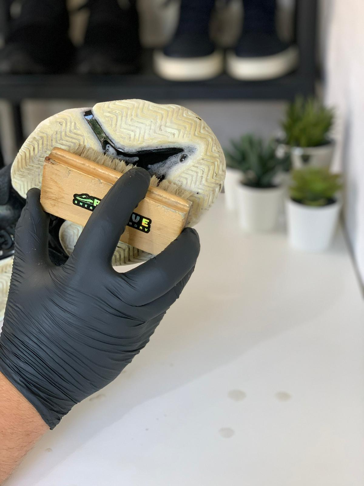 Cleaning sole of shoes in revive sneaker laundry