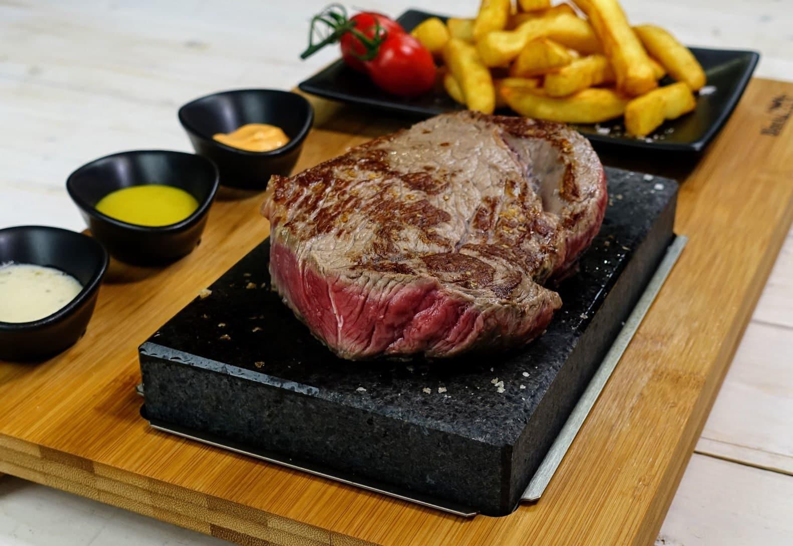 Steak on a hot stone in The Hemingways