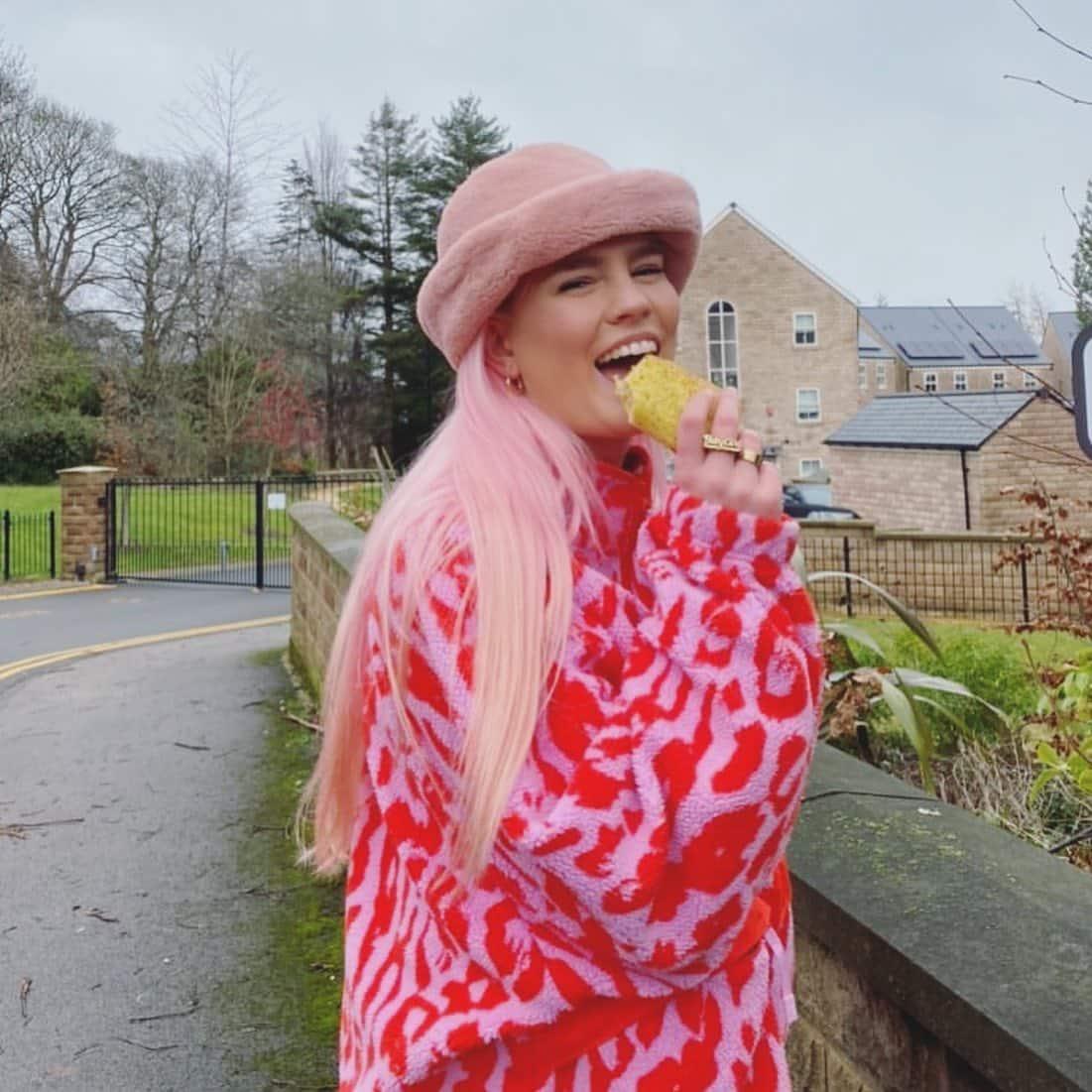 Girl in pink jacket eating