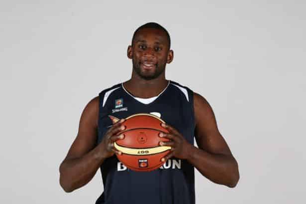 Olu Babalola holding basketball