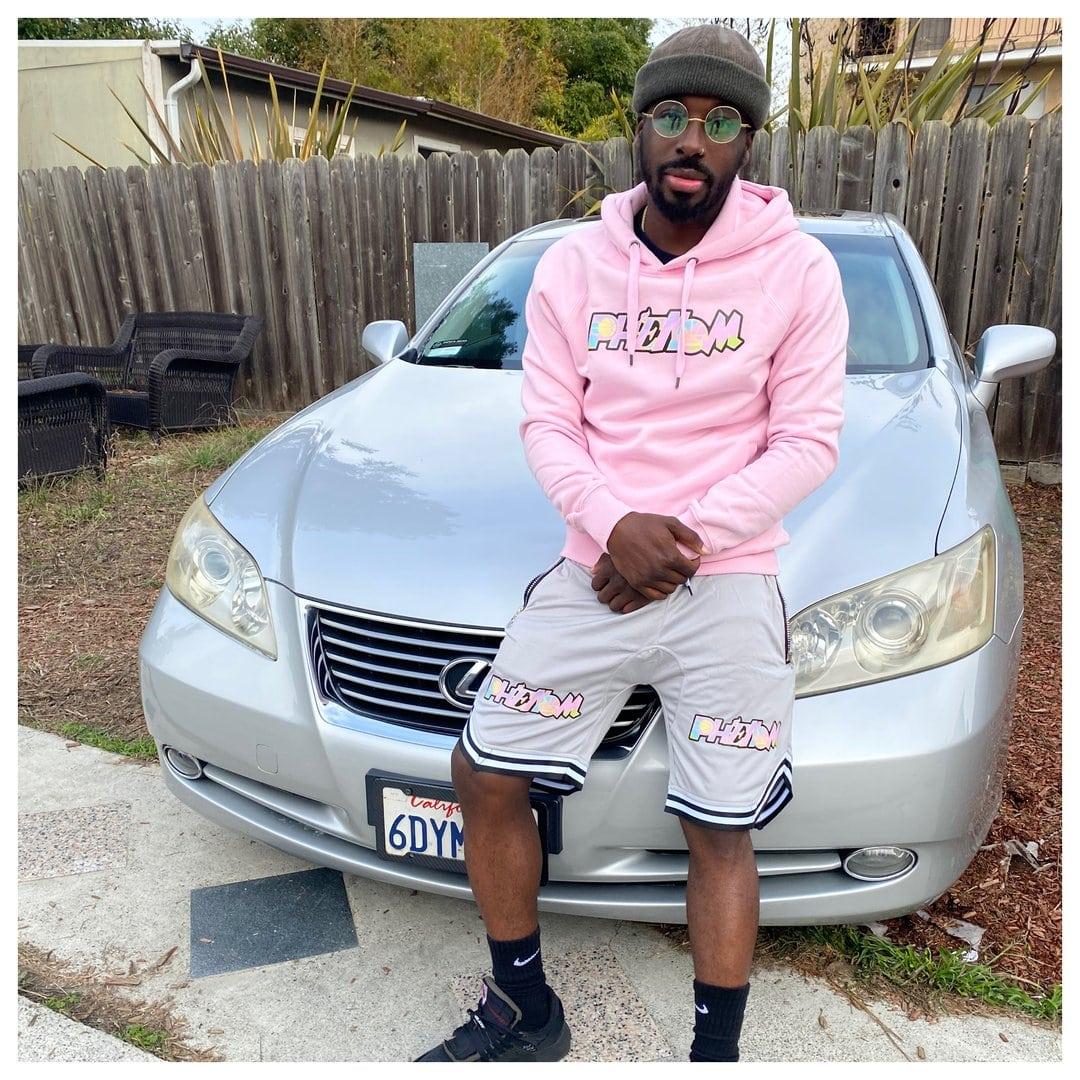 Guy wearing Pink Phenom Hoodie and shorts