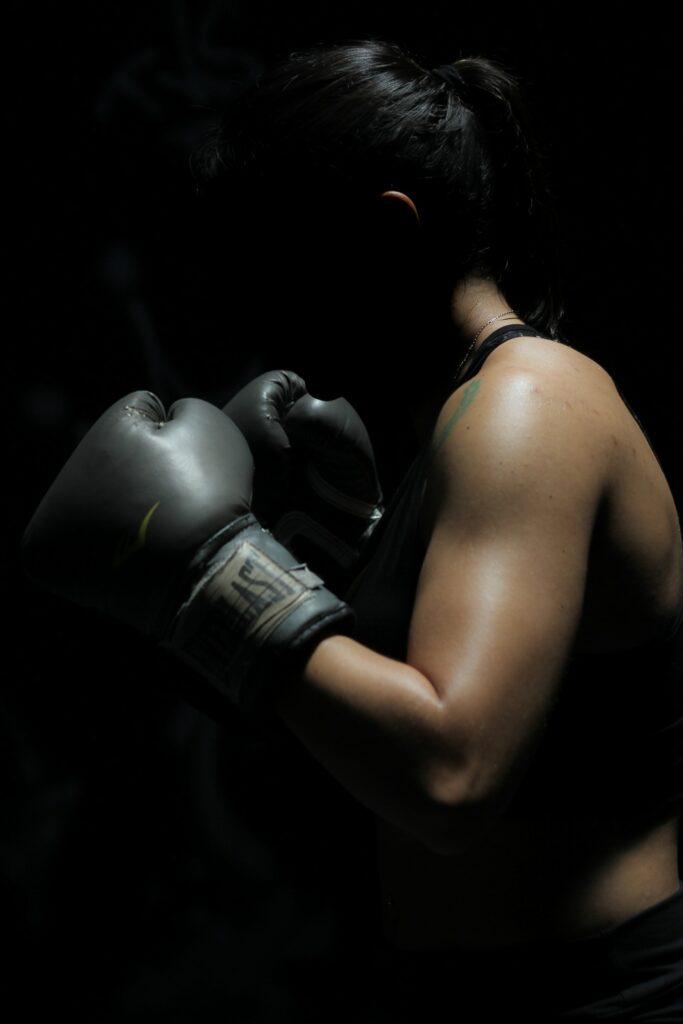 Woman boxing inside box barre