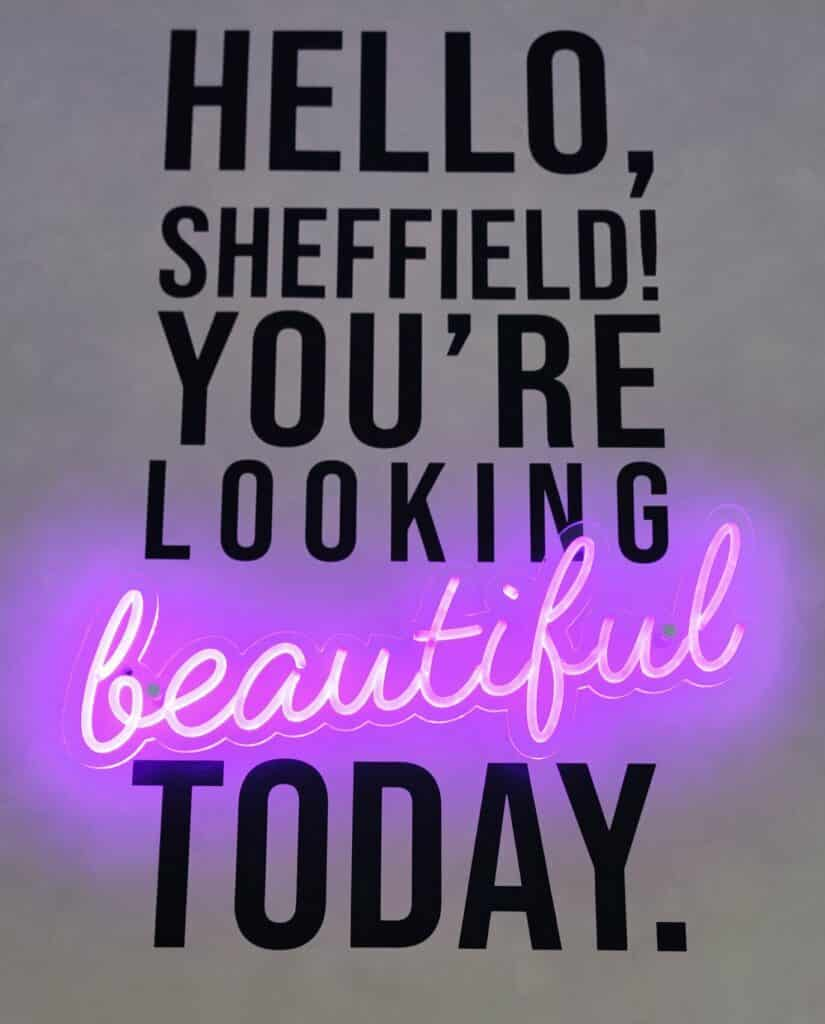 """a neon sign saying """"Hello, Sheffield you're looking beautiful today!"""""""