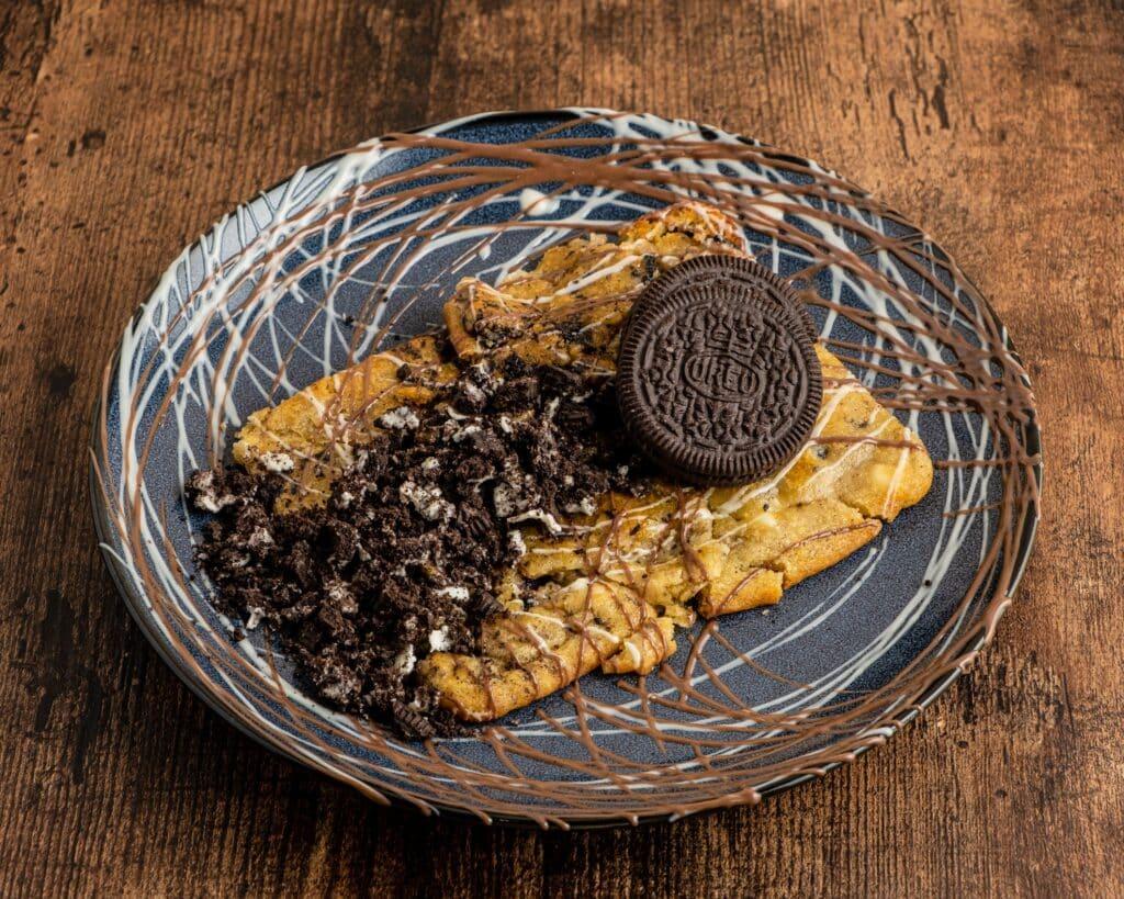 Oreo cookie dough on black plate